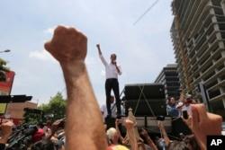 Opposition leader Juan Guaido speaks to supporters in Caracas, Venezuela, May 1, 2019.