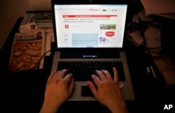 FILE - An Indian man is seen surfing the internet in New Delhi.