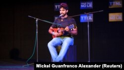 """Noche Blanca plays the quatro at the monthly spoken word event """"True Talk No Lies"""" in Port of Spain, Trinidad and Tobago, May 23, 2018."""