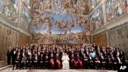 Pope Francis poses for a family photo with diplomats accredited to the Holy See inside the Sistine Chapel, at the end of an audience for the traditional exchange of New Year greetings, at the Vatican, Jan. 8, 2018.