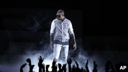 Chris Brown performs during the 54th annual Grammy Awards in Los Angeles, February 12, 2012. (AP Photo)