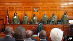 Six Supreme Court judges arrive at court to hear the petition by Kenya's Prime Minister Raila Odinga filed against president-elect Uhuru Kenyatta, March 25, 2013.