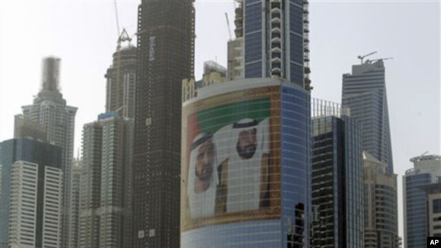 A giant image of Sheik Mohammed bin Rashid Al-Maktoum, UAE prime minister and ruler of Dubai, left, and Sheik Khalifa bin Zayed Al-Nahyan, UAE president, right, adorns a tower at Internet City on Sheikh Zayed highway in Dubai, March 9, 2011