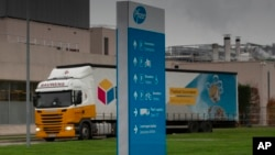 A truck leaves Pfizer Manufacturing in Puurs, Belgium, on Wednesday, Dec. 2, 2020. British officials authorized a COVID-19 vaccine for emergency use on Wednesday. (AP Photo/Virginia Mayo)