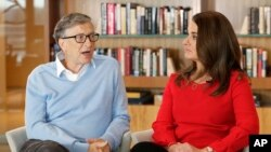 FILE - Microsoft co-founder Bill Gates and his wife Melinda are interviewed in Kirkland, Wash., Feb. 1, 2018.