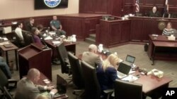 In this image from the Colorado Judicial Department video, Colorado theater shooter James Holmes (top L) in light-colored shirt, sits in Arapahoe County District Court, where his trial continues, July 23, 2015, in Centennial, Colorado.