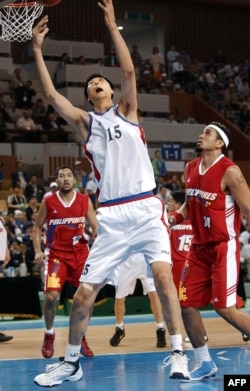 North Korean basketball player Ri Myoung-Hun competes at the 14th Asian Games in Busan, South Korea in Sept. 2002.