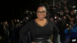 FILE -Actress Oprah Winfrey poses for photographers upon arrival at the premiere of the film 'A Wrinkle In Time' in London, March 13, 2018.