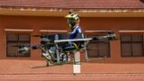 Lonh Vannsith, a fourth-year student of the National Polytechnic Institute of Cambodia, flies his team's drone in Phnom Penh, Cambodia, on September 17, 2021. REUTERS/Cindy Liu