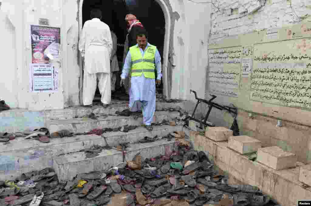 A rescue worker surveys the scene outside a Shi'ite mosque after an explosion in Shikarpur, Sindh province, Pakistan, Jan. 30, 2015.