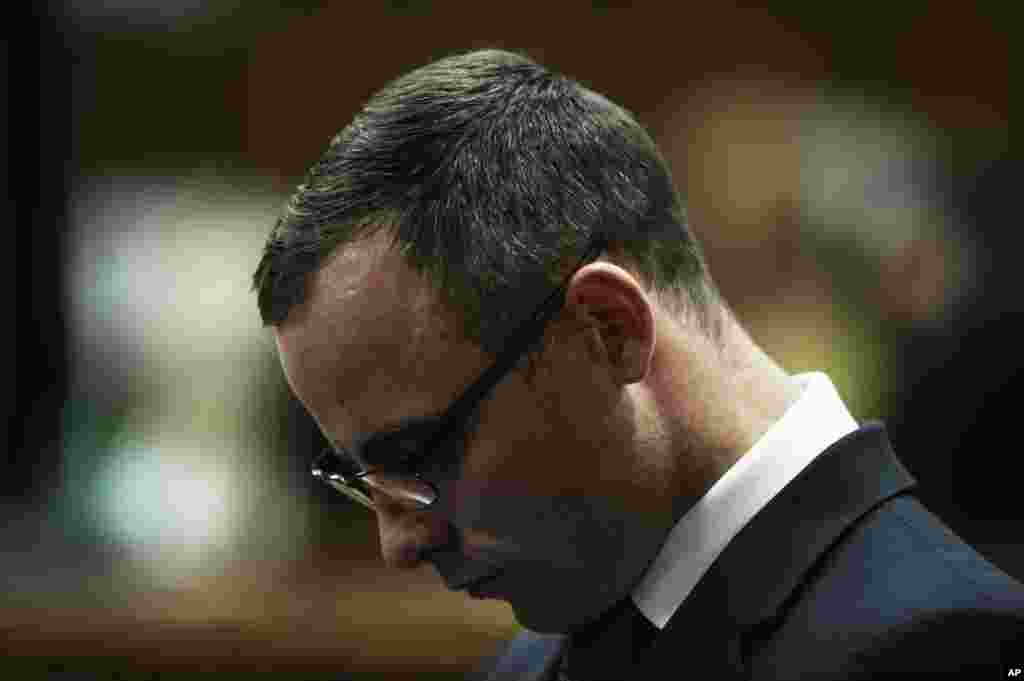 Oscar Pistorius stands in the dock in court in Pretoria, South Africa, May 14, 2014.