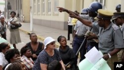 FILE: Zimbabwean police have been accused of disrupting peaceful gatherings like this WOZA meeting.