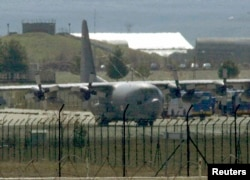 FILE- A U.S. Air Force C-130 transport plane is seen at a Turkish airbase. The U.S. military has been dropping supplies to rebels fighting Islamic State militants in northern Syria.