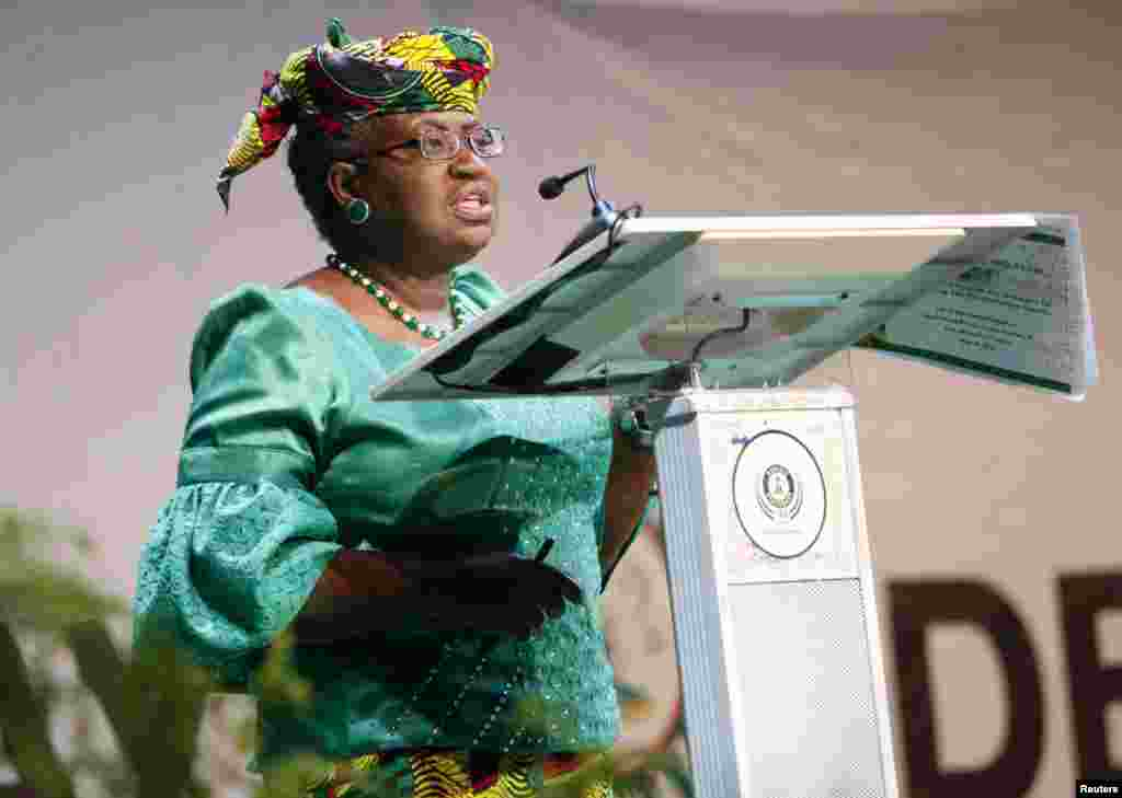 Nigeria's Finance Minister Ngozi Okonjo-Iweala address the audience on the achievements of President Goodluck Jonathan's administration while delivering the mid-term report during Democracy Day celebrations in Abuja May 29, 2013.