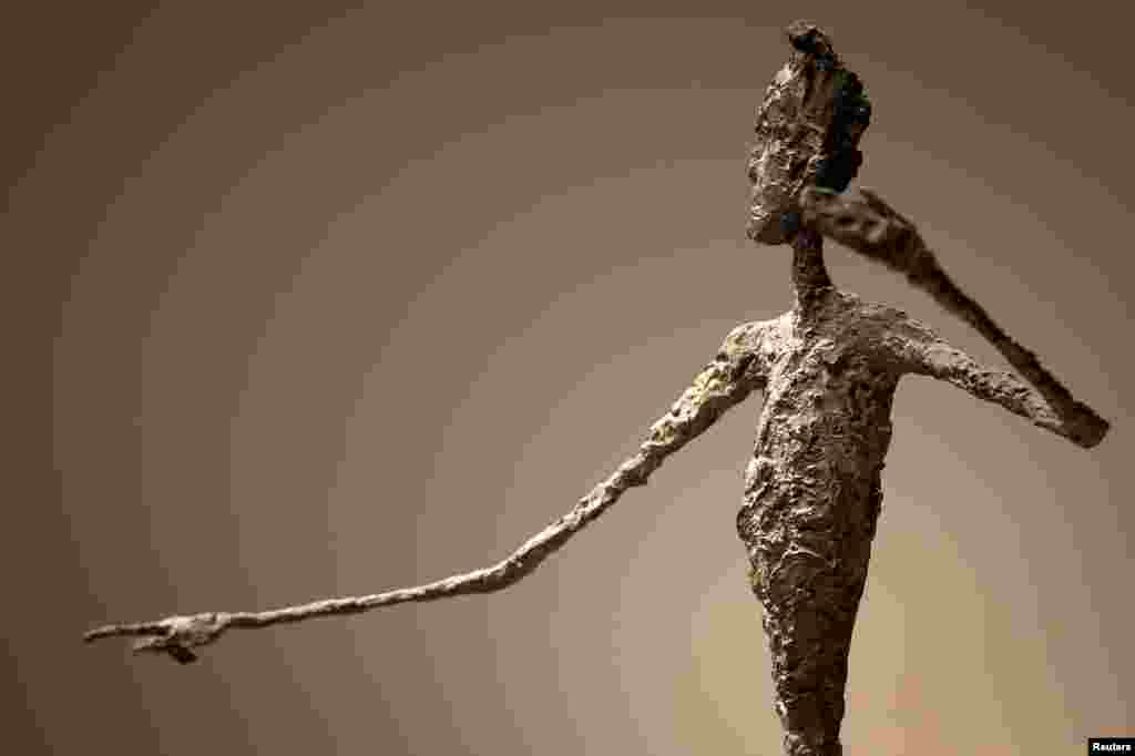 "The top half of Alberto Giacometti's ""L'homme Au Doigt"" (Pointing Man) sculpture is pictured at Christie's Auction House in the Manhattan borough of New York, May 11, 2015. The Giacometti sculpture set a world record price of $141.3 million."