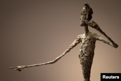 "The top half of Alberto Giacometti's ""L'homme Au Doigt"" (Pointing man) sculpture is pictured at Christie's Auction House in the Manhattan borough of New York May 11, 2015. The Giacometti sculpture set a world record price of $141.3 million."