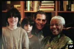 Nelson Mandela is godfather to both of the author's sons.