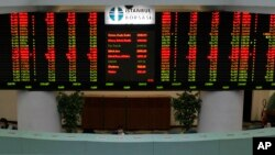 FILE - The display board of the Istanbul Stock Exchange in Istanbul, Turkey, is seen in a March 9, 2009, photo.