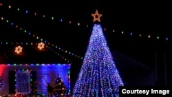 Christmas tree with colorful lights and stars in Kansas.