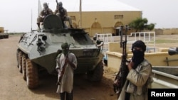 Fighters from the Al Qaeda-linked Islamist group MUJWA,,northern Mali. (file)