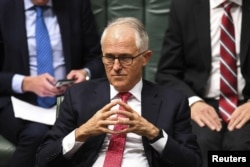 Then-Australian prime minister Malcolm Turnbull reacts during a debate at the House of Representatives, at Parliament House, in Canberra, Australia, Aug. 21, 2018. Turnbull was forced out Friday by party rivals.