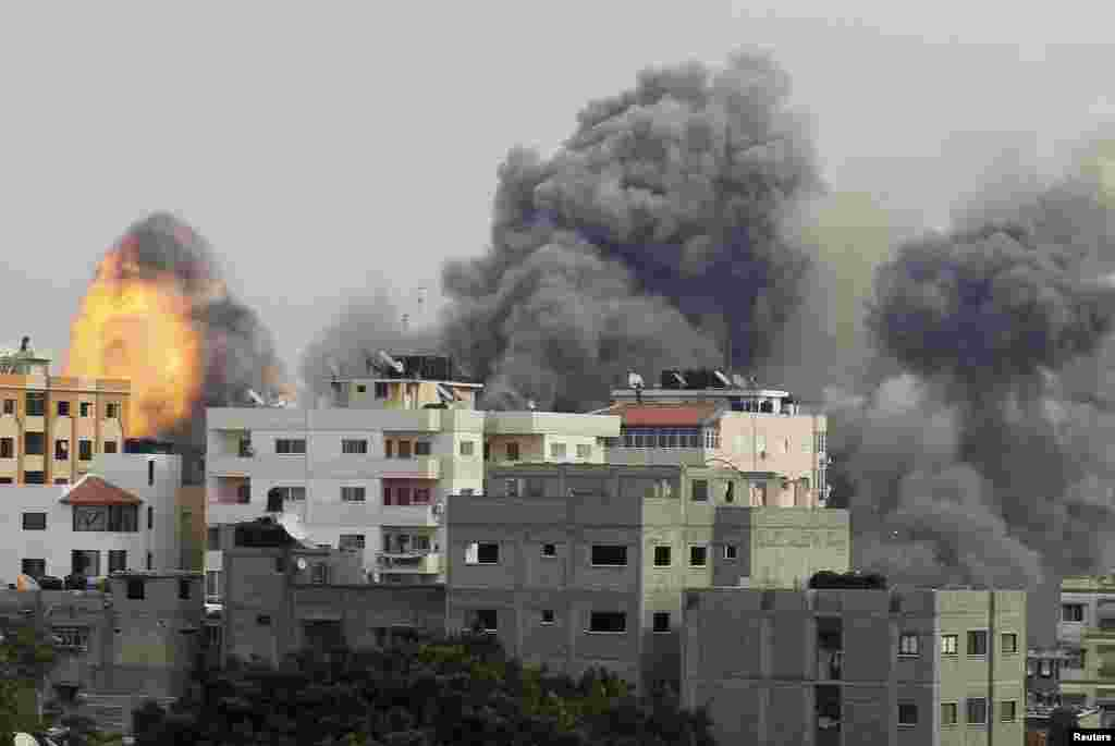Smoke and explosion are seen after what witnesses said was an Israeli air strike in Gaza City November 21
