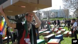 Protesters carried symbolic coffins to mark their opposition to U.S. military action.