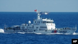 FILE - In this photo released by the 11th Regional Coast Guard Headquarters of Japan, a Chinese coast guard vessel sails near disputed East China Sea islands, Aug. 6, 2016.