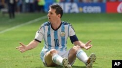 Argentina's Lionel Messi appeals for a foul during the World Cup quarterfinal soccer match between Argentina and Belgium at the Estadio Nacional in Brasilia, Brazil, Saturday, July 5, 2014. (AP Photo/Martin Meissner)