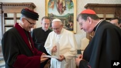 Pope Francis meets members of the joint commission for theological dialogue between the Catholic Church and the Assyrian Church of the East, at the Vatican, Nov. 24, 2017.