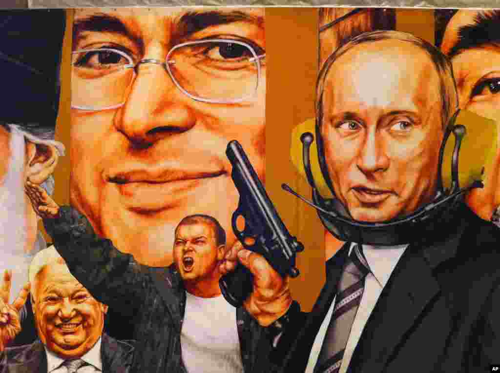 Vladimir Putin, the gunslinger, dominates a mural painted in 2007 by Dmitri Vrubel and Viktoria Timofeeva, showing the personalities of modern Russia. (VOA Photo/James Brooke)