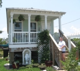 Cheryl Kring's rebuilt home in Waveland, Mississippi is one block from the beach. The elevated house is typical of the new landscape along the Mississippi Gulf Coast.