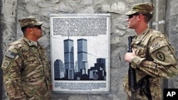 U.S. soldiers look at a Sept 11 memorial at the Jalalabad Air Field Base in eastern Afghanistan (File)