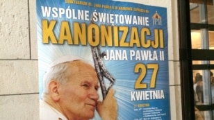 "Posters all around town say ""Communal Celebration of the canonization of John Paul II, April 27,"" Krakow, Poland, April 22, 2014. (Jerome Socolovsky/VOA)"
