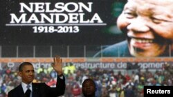 President Barack Obama addresses the crowd during a memorial service for Nelson Mandela at FNB Stadium in Johannesburg, South Africa, Dec. 10, 2013.