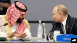 Saudi Arabia's Crown Prince Mohammed bin Salman, left, and Russia's President Vladimir Putin speak at the start of the G20 summit in Buenos Aires, Argentina.
