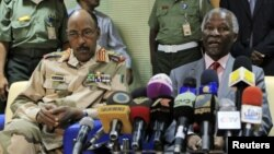 African Union mediator Thabo Mbeki, right, at joint press conference with Sudan Defense Minister Abdel Raheem Muhammad Hussein, in Khartoum (May file photo).