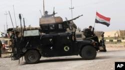 Iračke snage bezbednosti pripremaju se za bnapad na ekstremiste Islamske države u bazi Kamp Spajker, u maju prošle godine