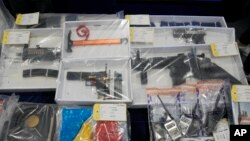 Seized evidence is displayed during a news conference as nine people were arrested over the alleged plot to plant bombs around Hong Kong, at police headquarters in Hong Kong, Tuesday, July 6, 2021.(AP Photo/Kin Cheung)