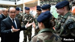 French President Francois Hollande speaks to young soldiers at the military school of Saint-Cyr-Coetquidan in Guer, Jan. 14, 2016.