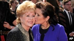 Debbie Reynolds, left, died one day after her daughter, Carrie Fisher.