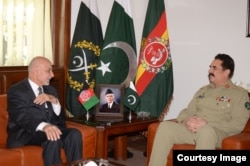 Afghan President Ashraf Ghani, left, meets with Pakistani General Raheel Sharif at army headquarters in Rawalpindi, Pakistan, Nov. 14, 2014. (Photo courtesy of Pakistani army)