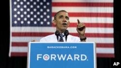 Presiden Barack Obama dalam kampanye di Universitas Georga Mason di negara bagian Virginia, Jumat (5/10).