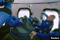 """Star Trek"" actor William Shatner experiences weightlessness during the apogee of the Blue Origin New Shepard mission NS-18 suborbital flight near Van Horn, Texas, in a still image from video, October 13, 2021. (Blue Origin/Handout via Reuters)"