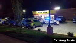 A police car is seen outside a Waffle House restaurant near Nashville, where three people were killed, 22 April, 2018. (Courtesy: Metropolitan Nashville Police Department)
