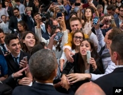 President Barack Obama shakes hands after speaking at a town hall meeting with local Argentinians at the Usina del Arte, in Buenos Aires, Argentina, March 23, 2016.