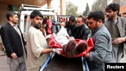 A wounded Afghan man arrives at a hospital in Jalalabad after a suicide attack that targeted funeral-goers in Laghman province, Afghanistan, Jan. 29, 2015. (REUTERS/ Parwiz)