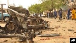 Hiện trường sau vụ nổ bom ở Kano, Nigeria, ngày 19/5/2014.