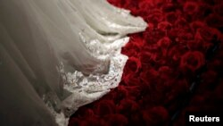 FILE PHOTO - A wedding dress is displayed during a group wedding ceremony hosted by the French Pavilion at the Shanghai World Expo May 11, 2010.REUTERS/Aly Song