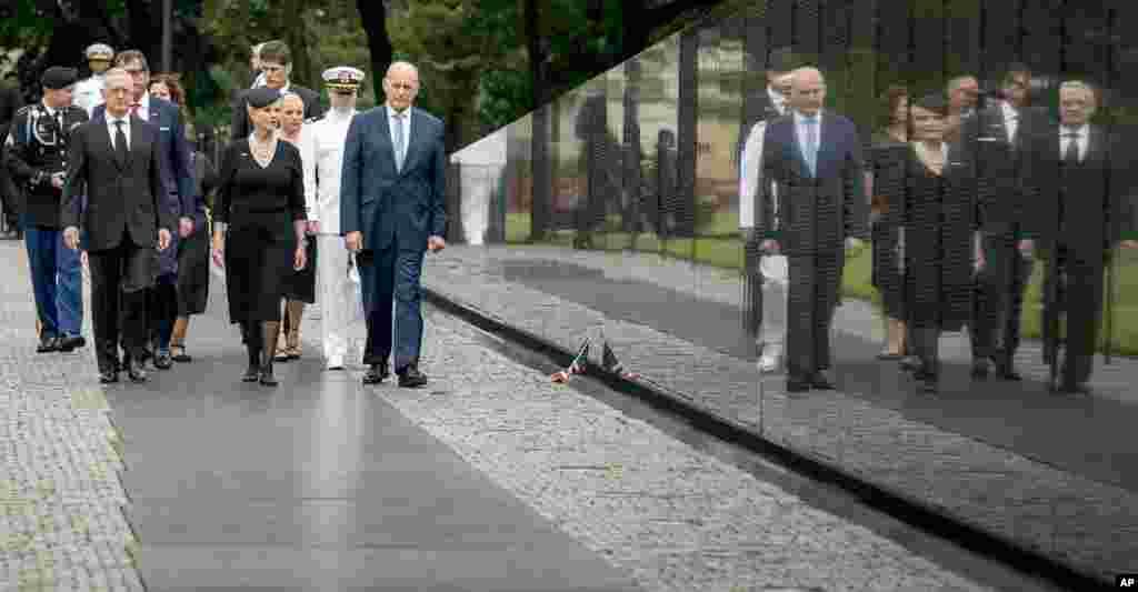 Cindy McCain, wife of, Sen. John McCain, accompanied by President Donald Trump's Chief of Staff John Kelly (R) Defense Secretary Jim Mattis (L) and family members, arrives at the Vietnam Veterans Memorial in Washington, Sept. 1, 2018.